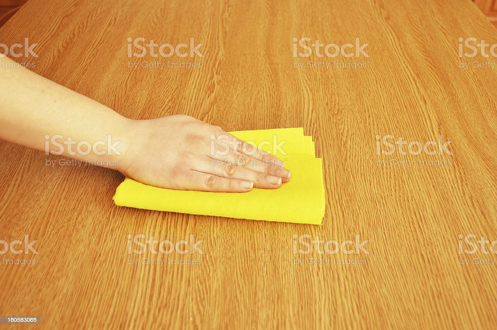 woman cleaning furniture table royalty-free stock photo