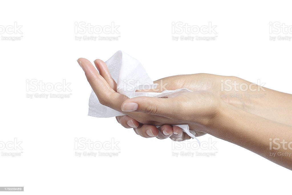 Woman cleaning her hands with a tissue stock photo