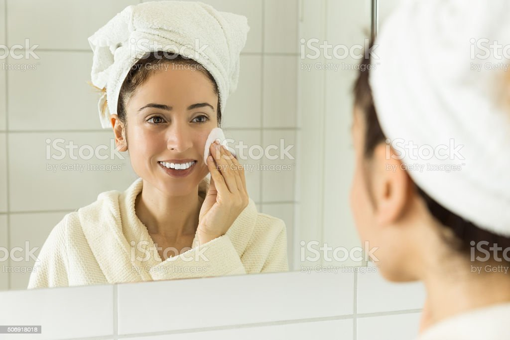 Woman cleaning her make up stock photo