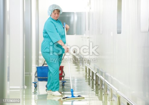 istock Woman cleaning hospital hall 177290310