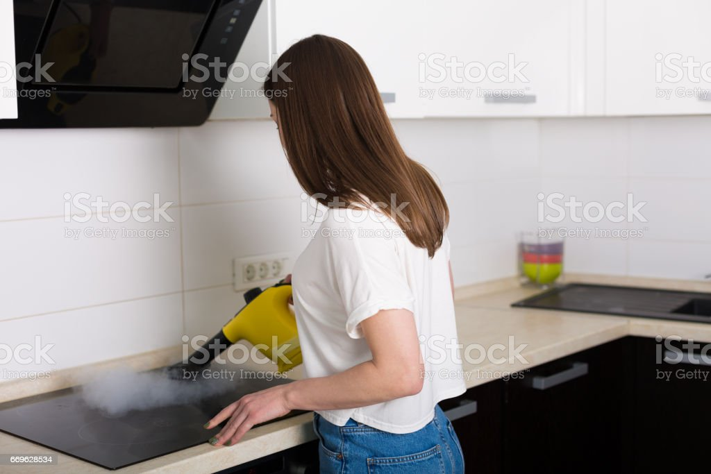 Woman Cleaning Kitchen With Steam Cleaner Stock Photo & More ...