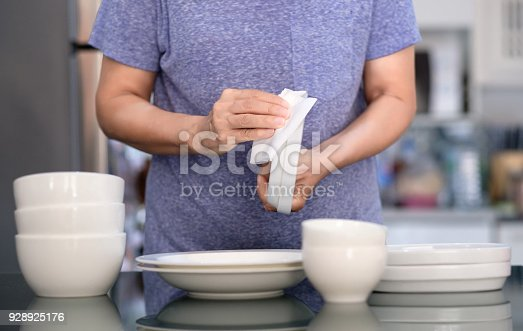 istock Woman Cleaning product concept wiping dishware cleaner in home and kitchen 928925176
