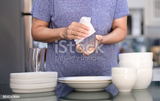 istock Woman Cleaning product concept wiping dishware cleaner in home and kitchen 934040694