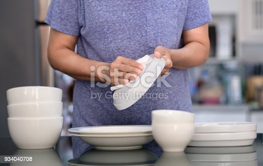 istock Woman Cleaning product concept wiping dishware cleaner in home and kitchen 934040708