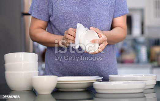 istock Woman Cleaning product concept wiping dishware cleaner in home and kitchen 936362558