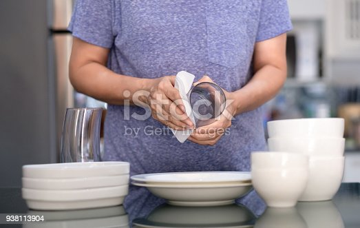 istock Woman Cleaning product concept wiping dishware cleaner in home and kitchen 938113904