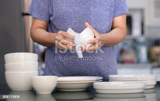 istock Woman Cleaning product concept wiping dishware cleaner in home and kitchen 938113926