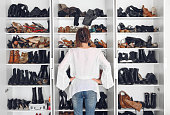 Woman cleaning shoes closet, while quarantined at home, Quebec, canada