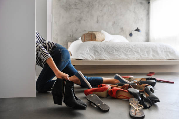 Woman cleaning shoes closet stock photo