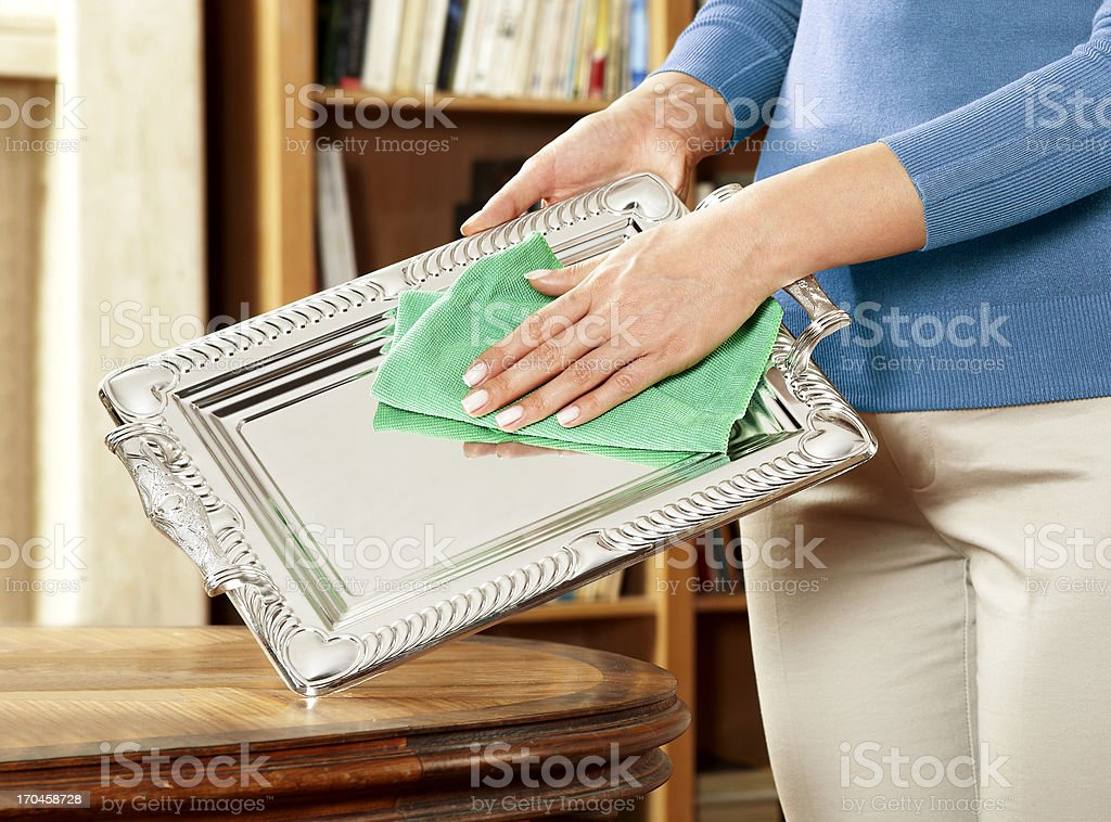Woman Cleaning Silverware stock photo
