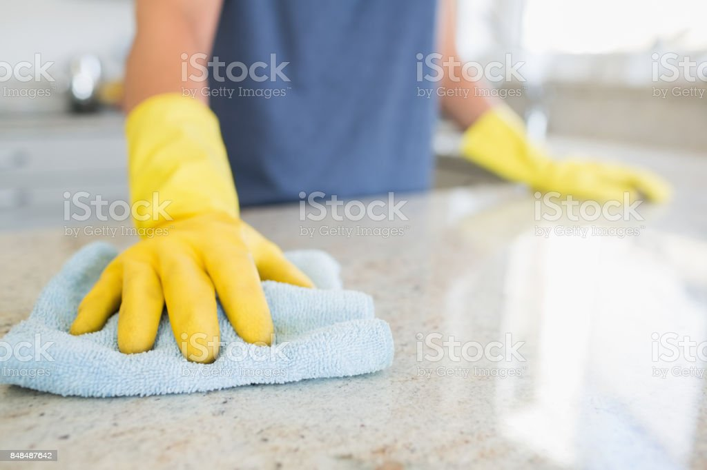 Woman cleaning the counter stock photo