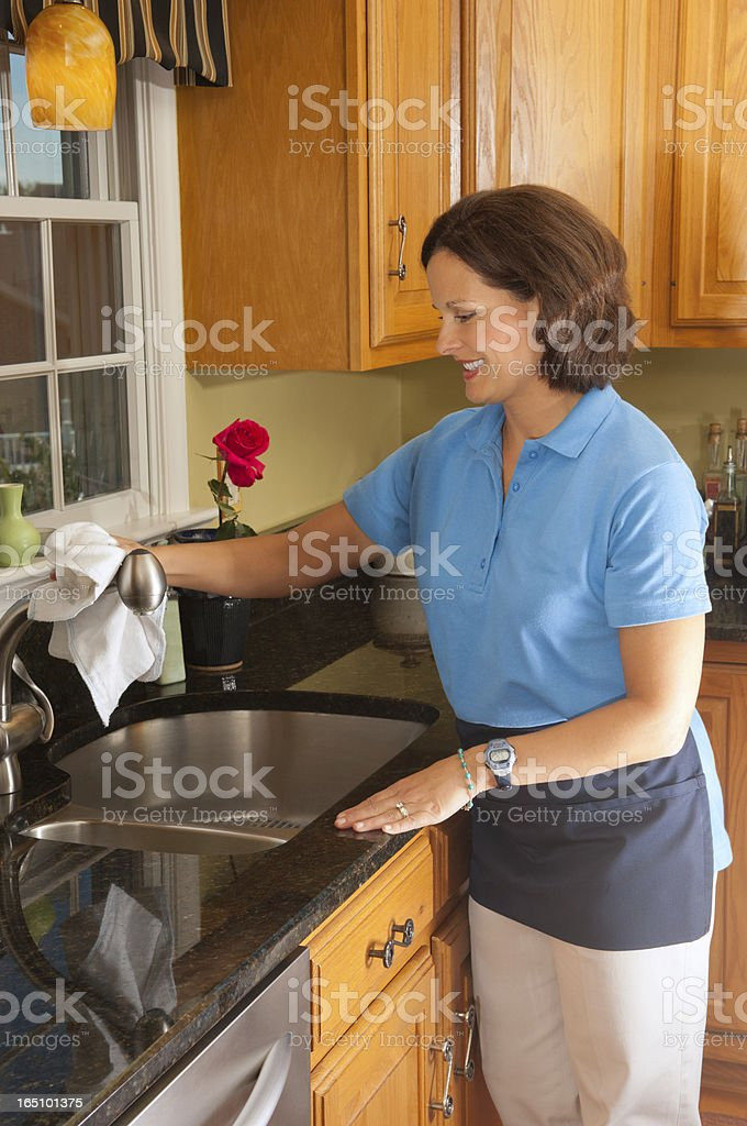 Woman Cleaning The Kitchen Sink stock photo
