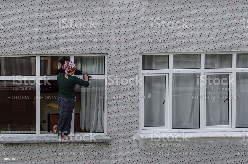 Woman cleaning the windows stock photo