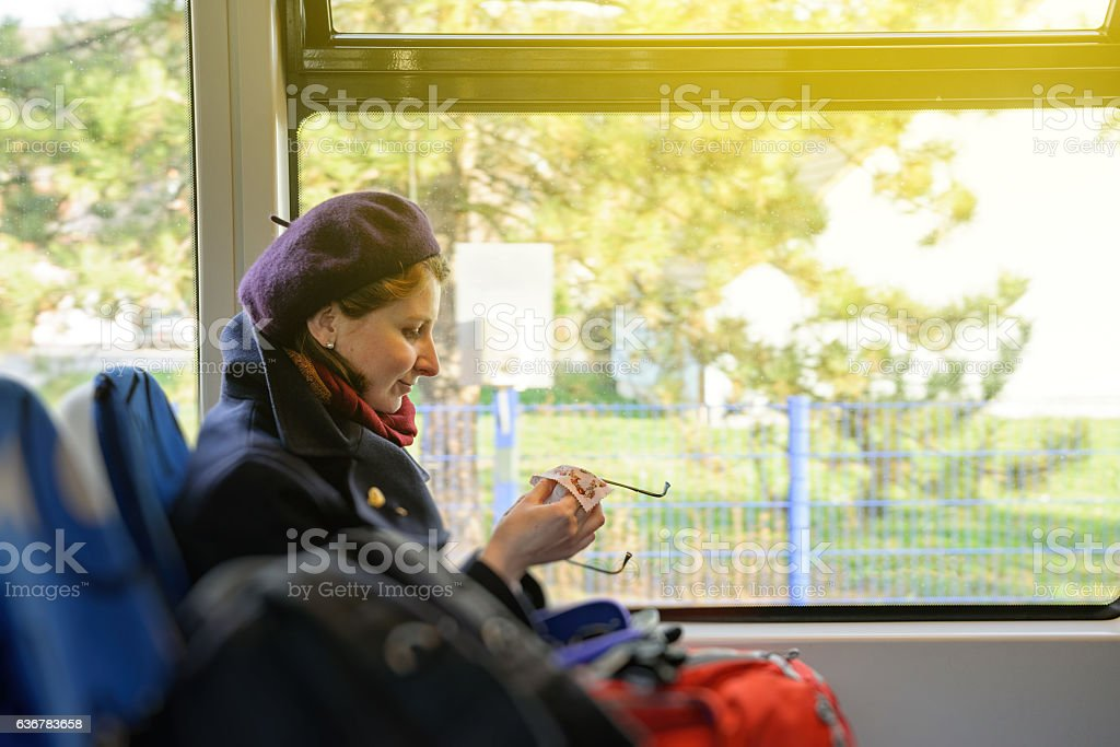 Woman cleaning with microfiber eyeglasses stock photo