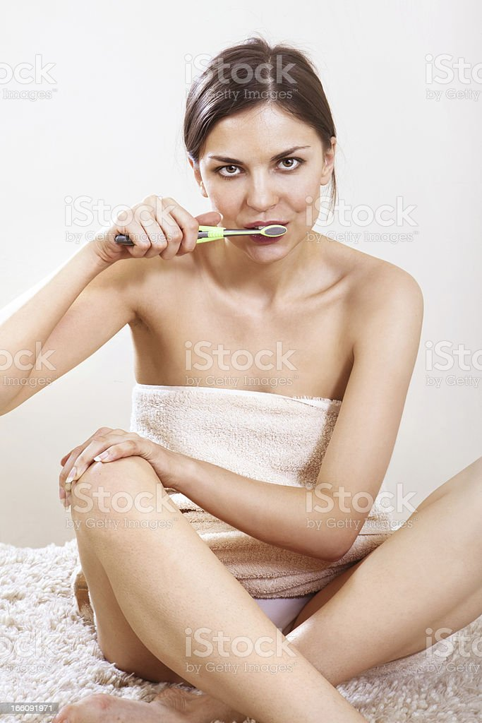 woman cleans her teeth royalty-free stock photo