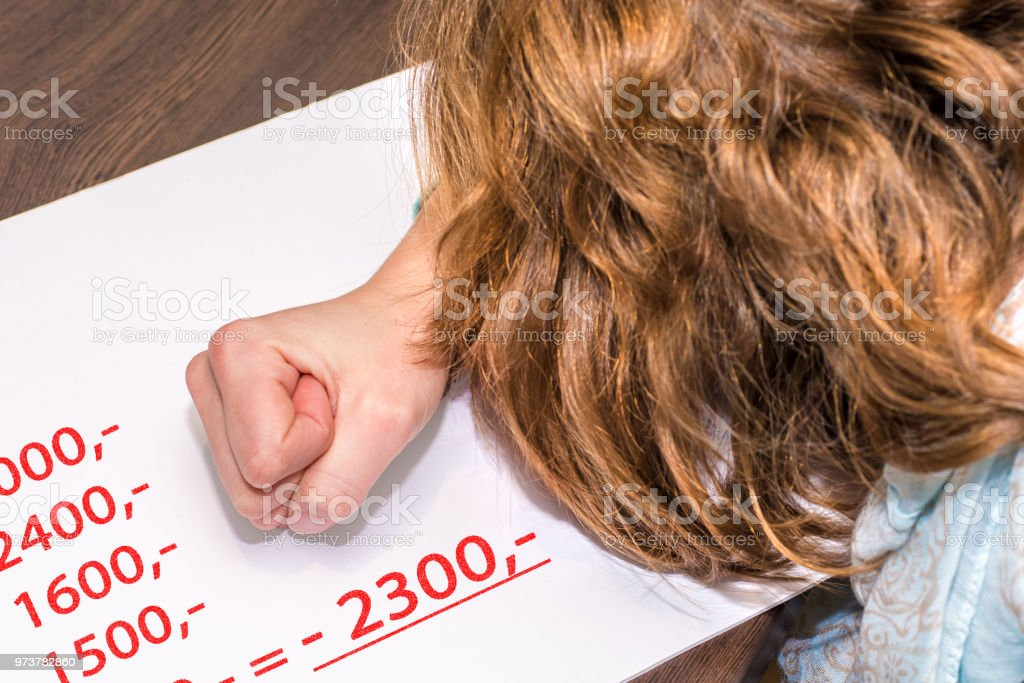 Woman clenched her hand desperately because of negative numbers stock photo