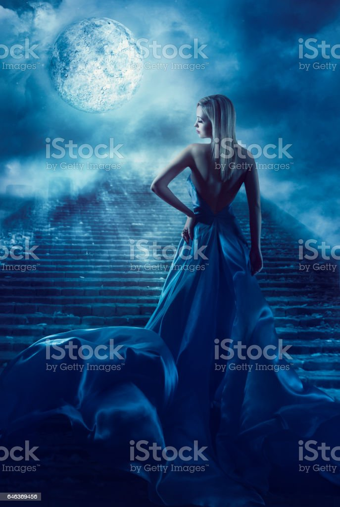 Woman Climb Up Stairs, Fantasy Moon Heaven, Night Blue Dress stock photo