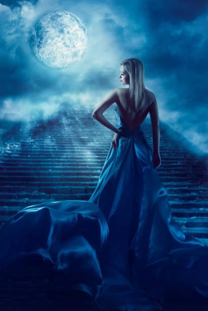 woman climb up stairs, fantasy moon heaven, night blue dress - abendkleid lang blau stock-fotos und bilder
