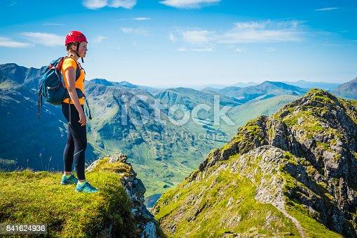 istock Woman climber on mountain ridge overlooking Glen Coe Highlands Scotland 841624936