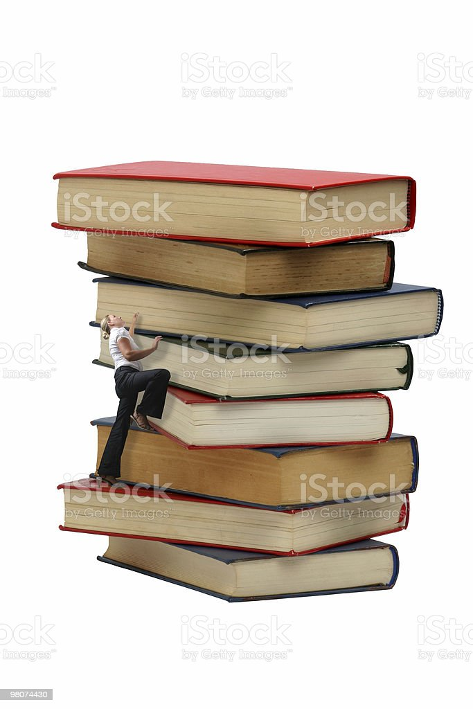 Woman Climbing a Pile of Books royalty-free stock photo