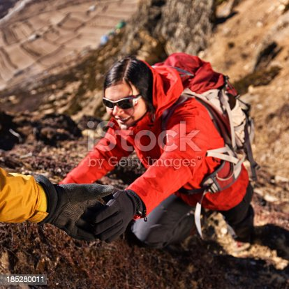 istock Woman climbing in Mount Everest National Park, Nepal 185280011
