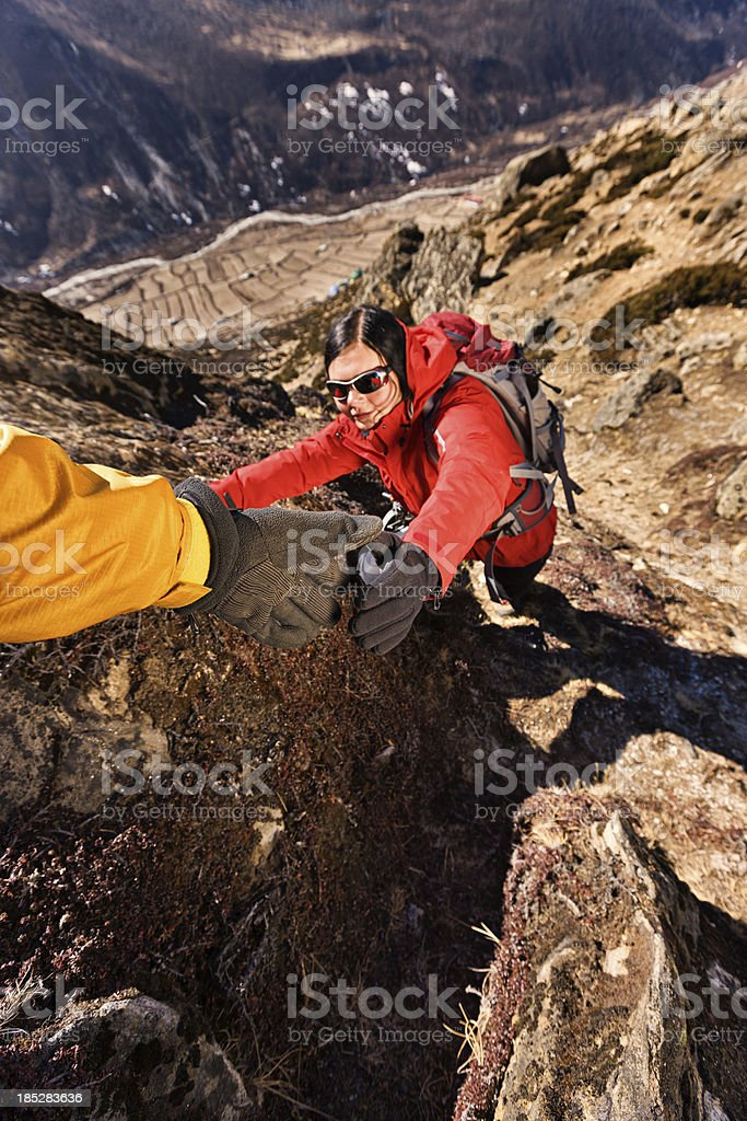 Woman climbing in Mount Everest National Park, Nepal royalty-free stock photo
