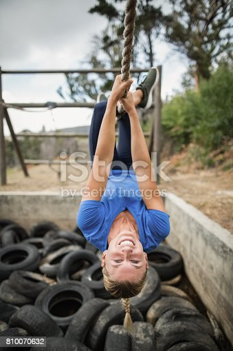 istock Woman climbing rope during obstacle course training 810070632