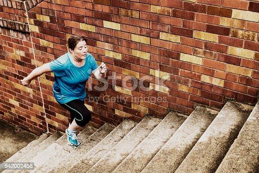 istock Woman Climbing Stairs 542002458