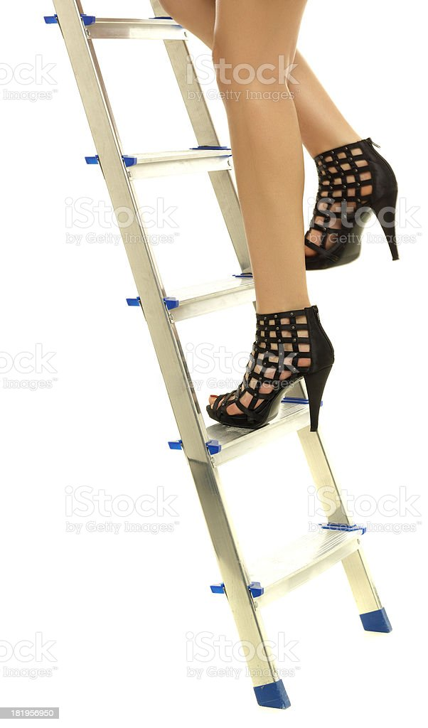 woman climbs the ladder royalty-free stock photo