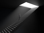 istock woman climbs the stairs from darkness to light 1286664973