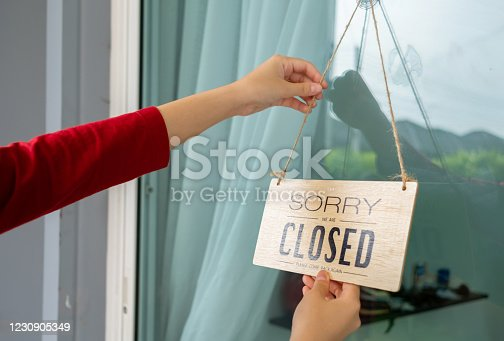 1213432934 istock photo Woman closed store with sign board front door shop, Small business come back turning agian after the situation is resolved. 1230905349