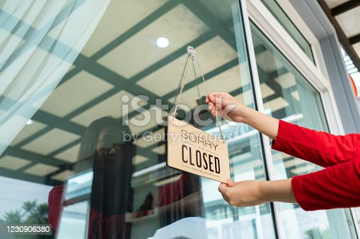 1213432934 istock photo Woman closed store with sign board front door shop, Small business come back turning agian after the situation is resolved. 1230906380