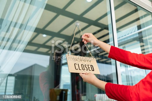 1213432934 istock photo Woman closed store with sign board front door shop, Small business come back turning agian after the situation is resolved. 1230908940