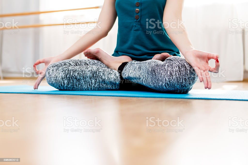 Woman closeup meditating and relaxing in lotus position royalty-free stock photo