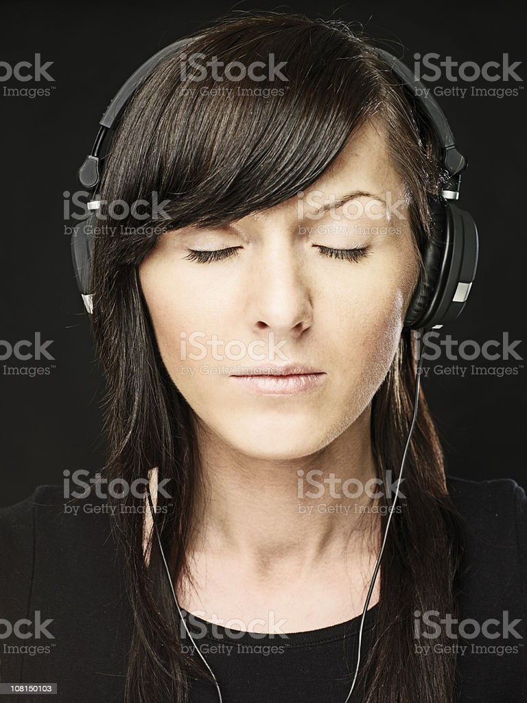 Woman Closing Eyes and Listening to Music royalty-free stock photo