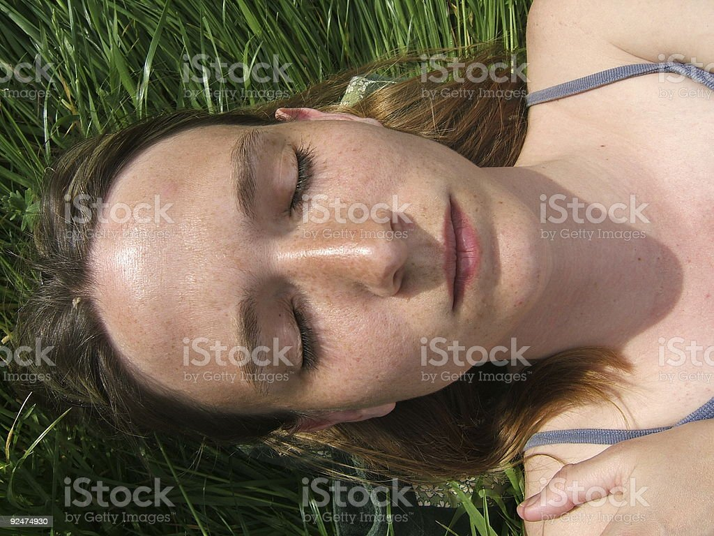 Woman closing her eyes royalty-free stock photo