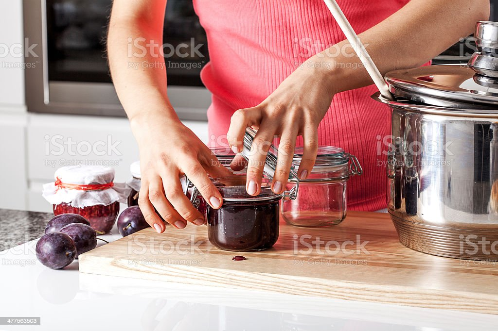 Woman closing the jars stock photo