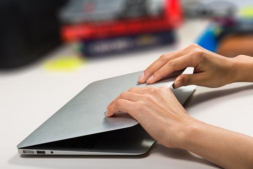 woman closing/opening her laptop