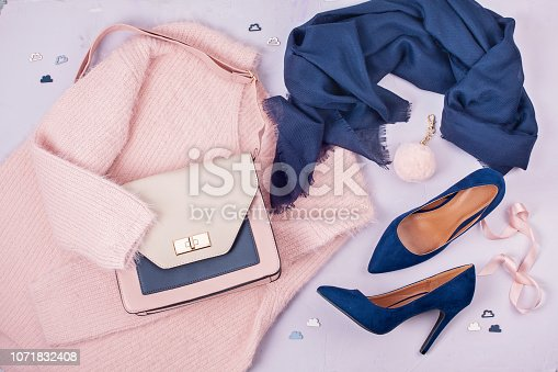 istock Woman clothing and accessories in pastel colors. 1071832408
