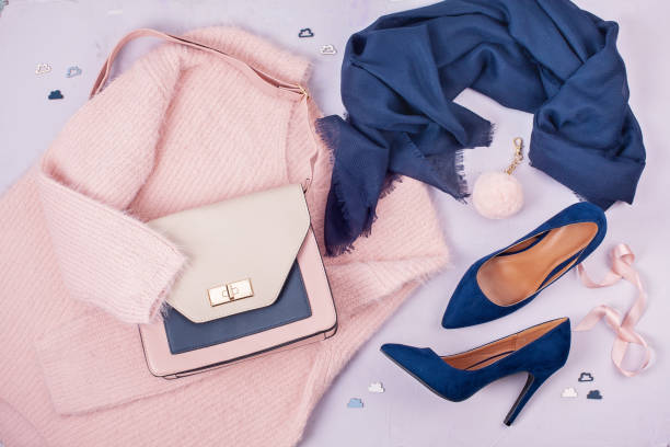 Woman clothing and accessories in pastel colors. Flat lay of woman clothing and accessories in pastel colors. Modern classic style concept fashion stock pictures, royalty-free photos & images