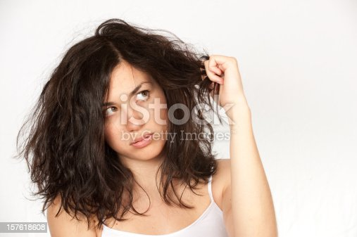 A woman looking at her bad hair.
