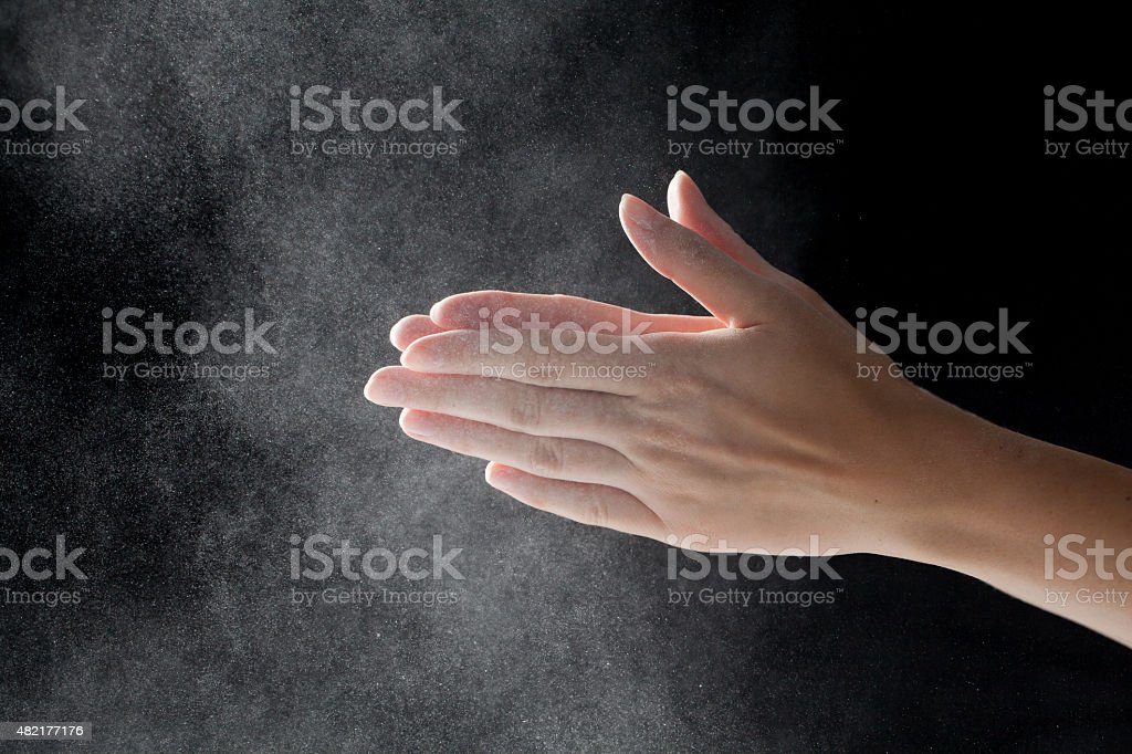 woman coating her hands in powder chalk magnesium stock photo