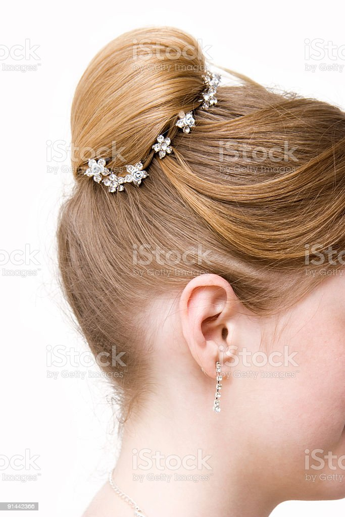 Woman coiffure with bun royalty-free stock photo