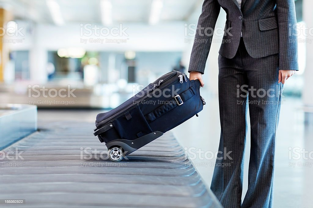 Woman Collecting Her Luggage stock photo
