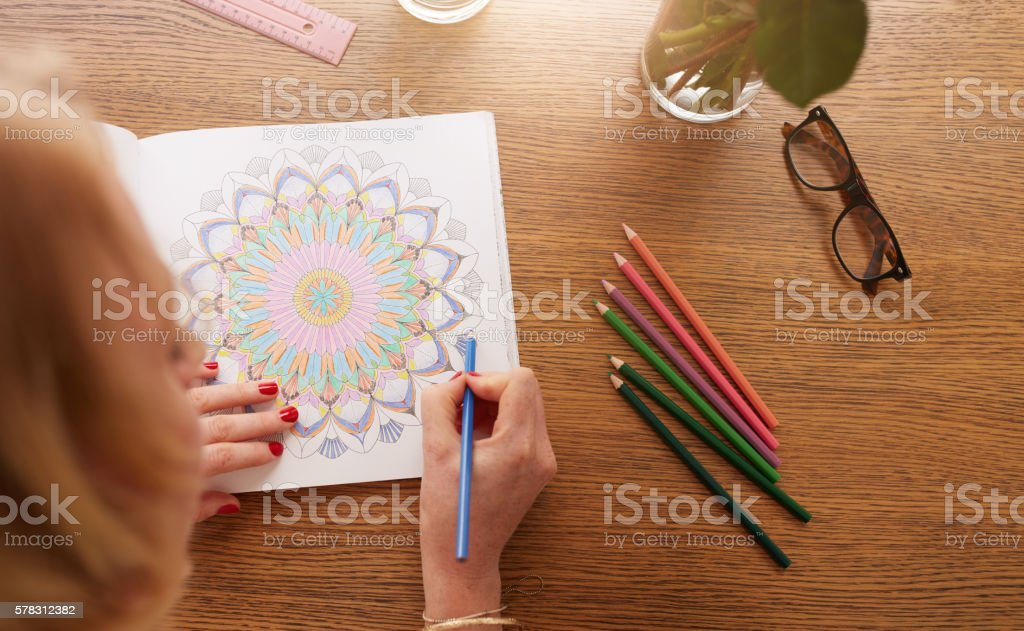 Woman coloring with color pencils for relaxation stock photo