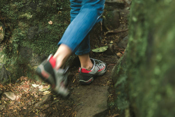 Woman comfortable boots shoes for tracking backpacking stock photo