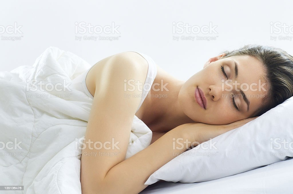 Woman Comfortable Sleeping in a White Bed stock photo
