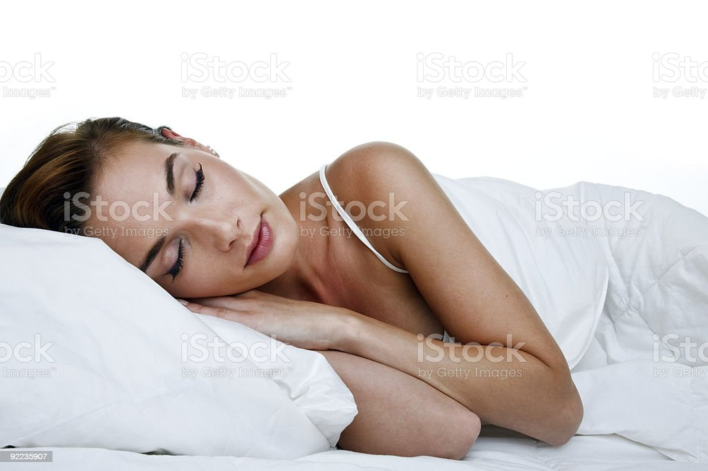 Woman comfortably sleeping in bed royalty-free stock photo