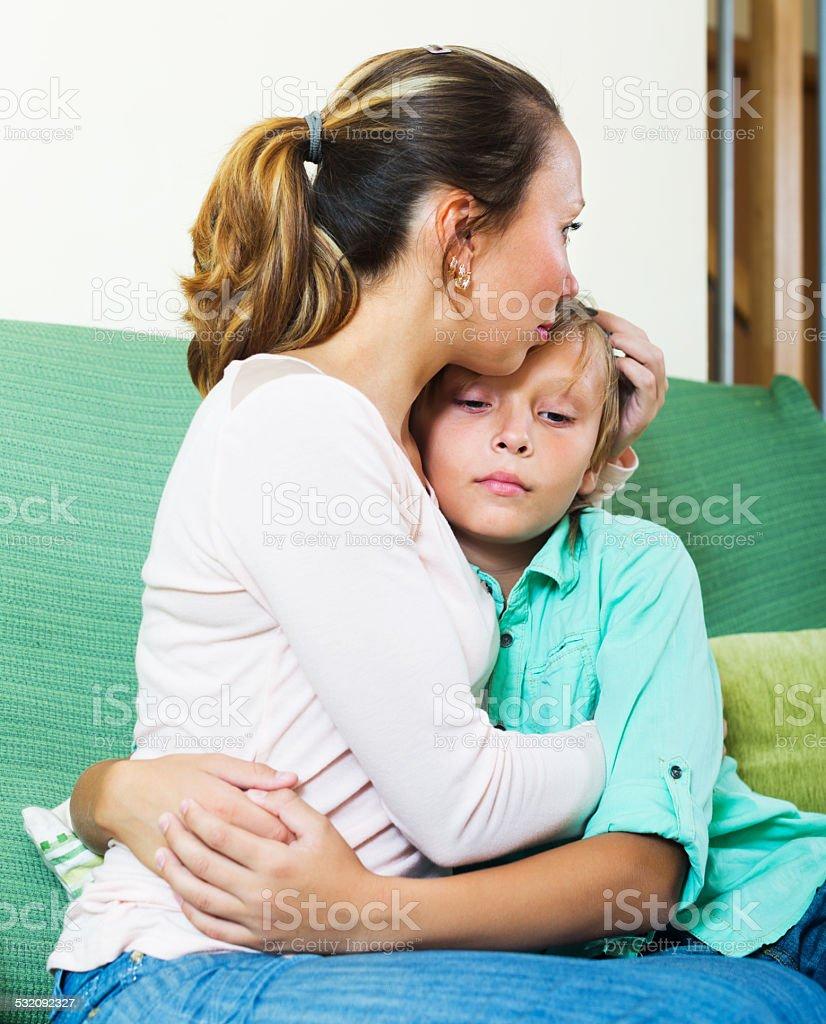 woman comforting crying teenager stock photo