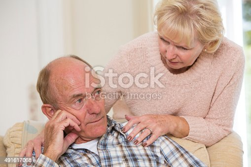 874789476istockphoto Woman Comforting Senior Man With Depression 491617068